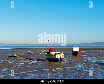 Boats on mudbank at low tide, Morecambe, Lancashire, England UK - Stock Photo