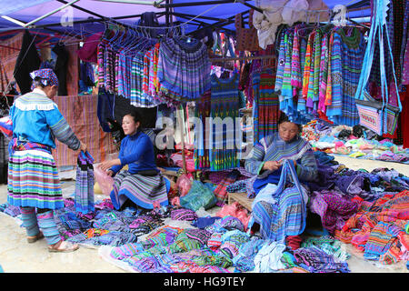 Flower Hmong ladies sell clothing at Bac Ha market - Stock Photo