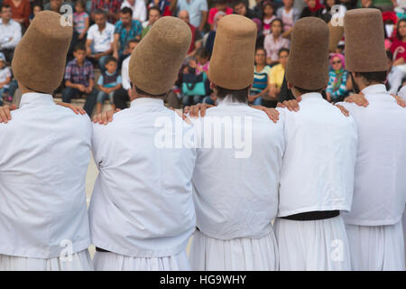Konya, Konya Province, Turkey.   Whirling Dervishes.  Line of dancers in initial stage of ceremony. - Stock Photo