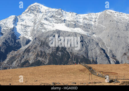 Lijiang, China - ovember 11,2016: Panoramic view of the Jade Dragon Snow Mountain in Yunnan, China and tourists - Stock Photo