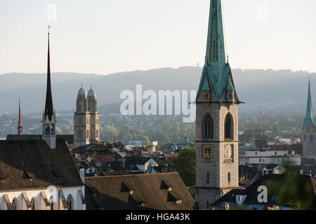 Zurich city panorama with Grossmunster cathedral, Predigerkirche and Fraumunster in the setting sun. - Stock Photo