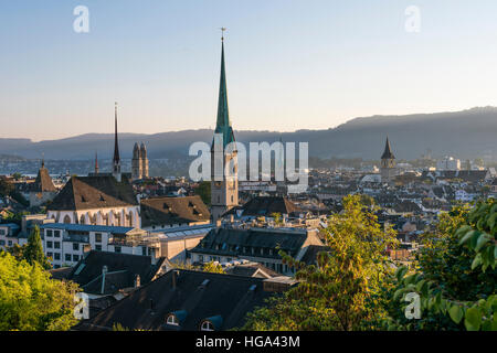 Zurich city panorama with Grossmunster cathedral, Predigerkirche, Fraumunster and St. Peter in the setting sun. - Stock Photo