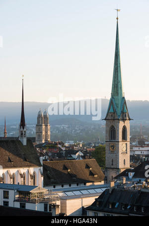 Zurich city panorama with the twin towers of Grossmunster cathedral and Predigerkirche in the setting sun. - Stock Photo