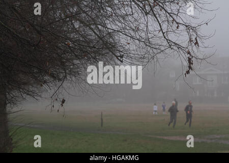 Wimbledon London,UK. 7th January 2017. Joggers  on a grey dull morning on Wimbledon Common Credit: amer ghazzal/Alamy - Stock Photo