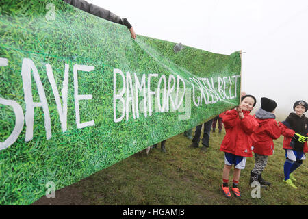 Rochdale, Lancashire, UK. 7th January, 2017. A youngster holding a banner which reads 'Save Bamford green Belt', - Stock Photo
