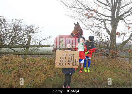 Rochdale, Lancashire, UK. 7th January, 2017. Children stood next to a horse in a field holding placards to save - Stock Photo