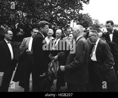 President John F. Kennedy visits with reporters. - Stock Photo