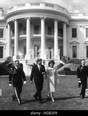 President John F. Kennedy and the First Lady in front of White House. - Stock Photo