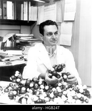 Dr. Marshall Nirenberg holding DNA models. - Stock Photo