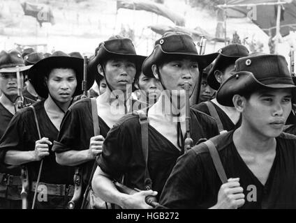 Young Vietnamese men return to their native villages after military training. - Stock Photo