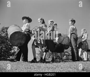 Young children collect scrap to donate for our war industries, 1942. - Stock Photo