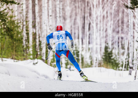 skier athlete men in woods free style during Championship on cross country skiing - Stock Photo