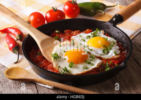Traditional Mexican breakfast fried egg with salsa closeup in the pan. Horizontal - Stock Photo