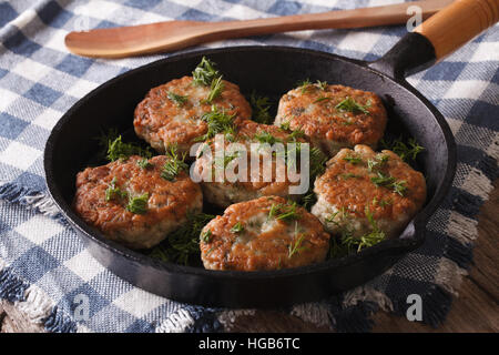 fishcakes with herbs close-up in a pan on the table. Horizontal - Stock Photo