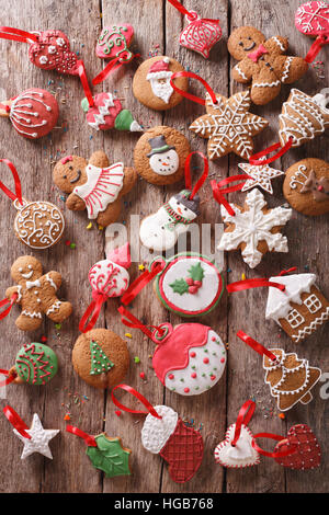 Christmas gingerbread on wooden background. Vertical view from above - Stock Photo