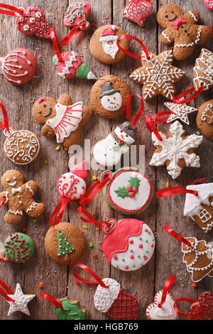Christmas gingerbread on wooden background close-up. Vertical view from above - Stock Photo