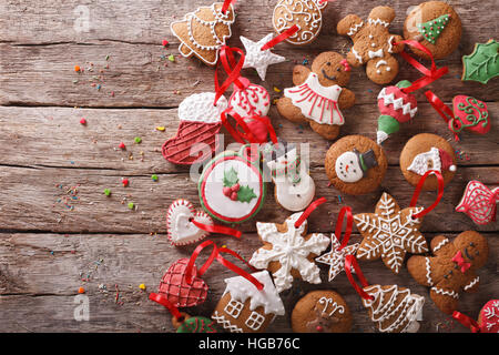 Christmas gingerbread on wooden background close-up. horizontal view from above - Stock Photo