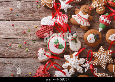 Beautiful background Christmas gingerbread on a wooden table close-up. horizontal view from above - Stock Photo