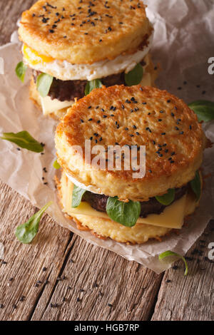 Two ramen burger close-up on a wooden table. vertical - Stock Photo