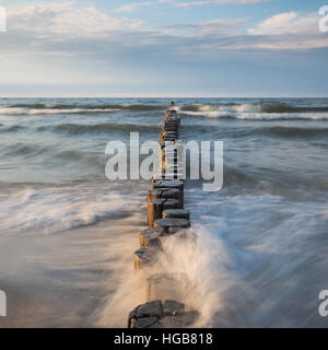 Baltic Sea with breakwaters at daylight - Stock Photo