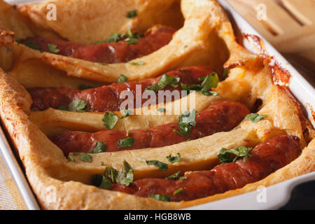 A delicious English sausage baked in pastry in a dish macro. horizontal - Stock Photo