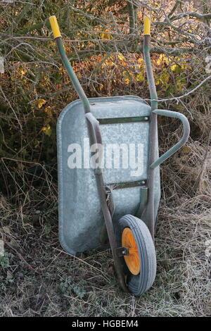 Hardy gardener - frozen wheelbarrow - Stock Photo