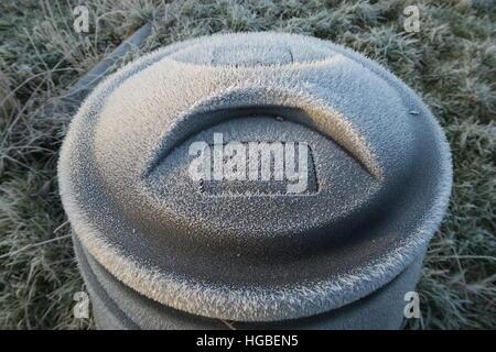 Hardy gardener - frozen compost bin - Stock Photo