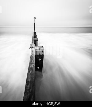 Black and White seascape of pier - Stock Photo