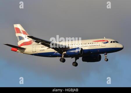 British Airways Airbus A319-131 G-EUPX landing at London Heathrow Airport, UK - Stock Photo