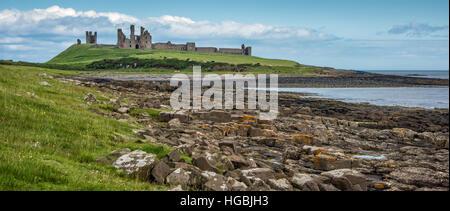 Dunstanburgh Castle, Northumberland Coast, UK - Stock Photo
