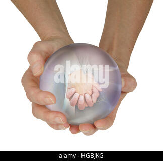 female fortune teller with large crystal ball held in cupped hands with a vision of a couple holding hands within, - Stock Photo