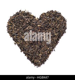 Heart shape black tea isolated on white - Stock Photo