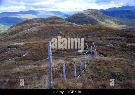 Old Boundary Fence on the Ridge to the Graham Creag Mhor from the Corbett Beinn Stacath (Stob Fear-tomhais) Scottish - Stock Photo