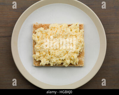 Healthy Calorie Controlled Cooked Breakfast Of Fresh Scrambled Eggs On Toast Meal Ready To Eat With No People And - Stock Photo