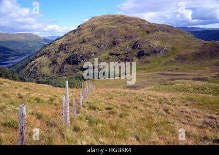 Old Boundary Fence on the Ridge to the Graham Creag Mhor from the Corbett Beinn Stacath (Stob Fear-tomhais) Scottish - Stock Photo