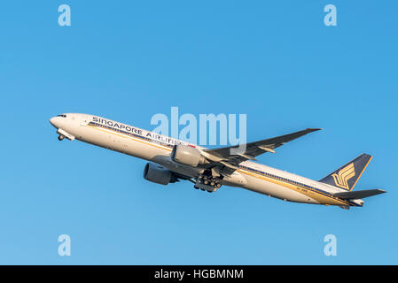 Singapore Airlines Boeing 777 taking off from Sydney International Airport, Australia in late evening - Stock Photo