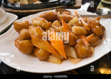 Sweet and sour chicken with vegetable on a plate - Stock Photo