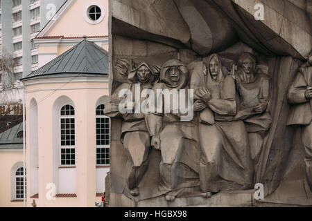 Bas-relief of the Soviet era on old facade building on Nemiga Street in Minsk, Belarus - Stock Photo