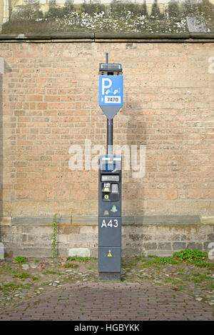 DEVENTER, NETHERLANDS -DECEMBER 24, 2016: Toll ticket parkingzone: an automatic device to pay for parking. - Stock Photo