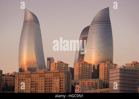 Flame Towers during sunrise of Baku. Flame Towers are new skyscrapers in Baku, Azerbaijan - Stock Photo