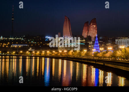 Flame Towers and illumination of Baku. Flame Towers are new skyscrapers in Baku, Azerbaijan - Stock Photo