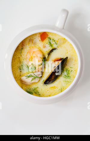 Scandinavian creamy fish soup with halibut, prawns and mussels - Stock Photo
