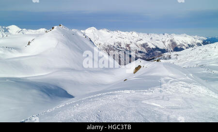 Snow mountains peaks landscape viewed from skiing piste in 3 Valleys winter resort - Stock Photo