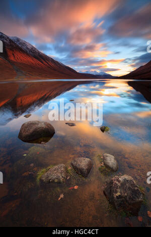 Sunset reflected in Loch Etive captured from near Gualachulain in the Scottish Highland. - Stock Photo