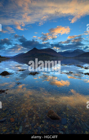 Sunrise captured from the North Shore of Loch Leven in the Scottish Highlands with the Pap of Glencoe in the distance.