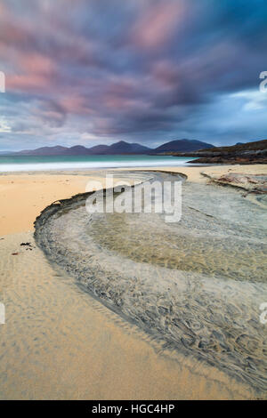 A steam on Luskentyre (Losgaintir)  Beach on the Isle of Harris captured at sunset. - Stock Photo
