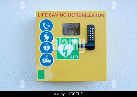 Automated external defibrillator mounted on a outside wall - Stock Photo