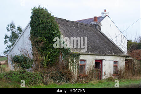 A Traditional Irish Rural Farm Building With Thatched Roof