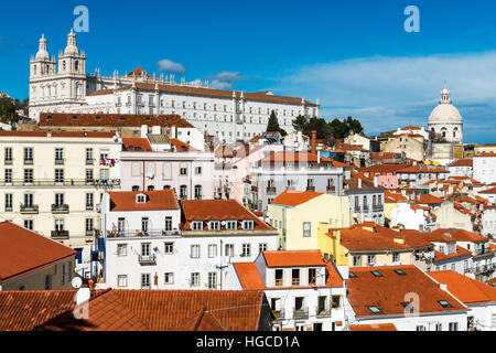 View of the Alfama Neighborhood in Lisbon, Portugal, with colorful buildings and the National Pantheon - Stock Photo
