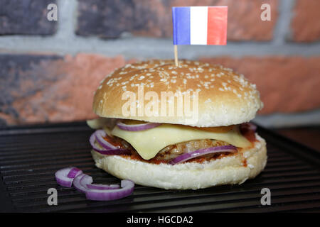 Hamburger with beef, cheese, onion, tomato and sauce. Homemade burger. French flag - Stock Photo